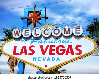 Las Vegas, USA - February 02, 2020: Welcome to fabulous las vegas sign and palm trees over blue sky in united states of america