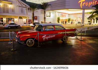 Las Vegas, USA - January 2016 : Red vintage car parked at the entrance of the Tropicana Las Vegas on the strip at night