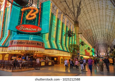 Las Vegas, USA - January 3, 2018 : Binion's Gambling Hall on Fremont Street with many neon lights and tourists. Founded in 1951 as Binion's Horseshoe it is one of the oldest casinos in Las Vegas.