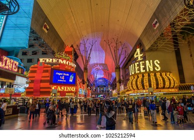Las Vegas, USA - January 3, 2018 : Fremont casino and Four Queens on Fremont Street with many neon lights and tourists.