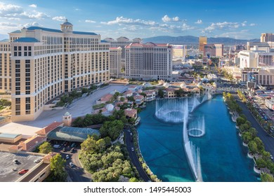 LAS VEGAS, USA - July 2, 2019: View Bellagio and Caesars Palace hotels and casino as seen on July 2, 2019 in Las Vegas, USA. Aerial view of fountain show and Las Vegas strip in Nevada at sunset.