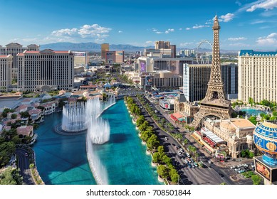 LAS VEGAS, USA - July 24, 2017: World famous Las Vegas Strip as seen on July 24, 2017 in Las Vegas, USA. Aerial view of fountain show and Las Vegas strip in Nevada at sunset.