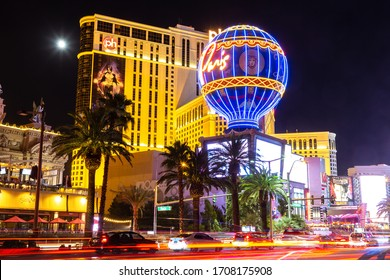 LAS VEGAS, USA - MARCH 29, 2020: Planet Hollywood and Paris Las Vegas hotel and casino at night in Las Vegas, Nevada, USA