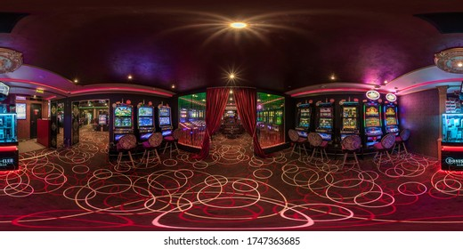 LAS VEGAS, USA - MAY, 2017: full seamless hdri panorama 360 degrees view in interior elite luxury vip casino with rows of slot machines in red style in equirectangular spherical projection. VR content