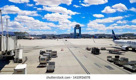 LAS VEGAS, U.S.A. - MAY 27, 2019: Runway and transportation vehicles at the McCurran Airport in Las Vegas, U.S.A.