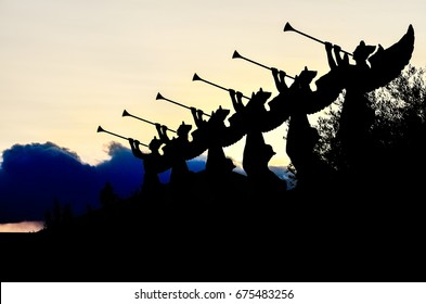 Las Vegas, USA - May 7, 2014: Silhouettes of angels blowing trumpets in Nevada city during sunset by Caesars Palace hotel and casino