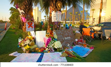 Las Vegas, USA - OCT 07 ,2017 : Laying flowers and lighting candles for victims of Las Vegas shooting victims.  Near the Mandalay Bay on the Las Vegas St.
