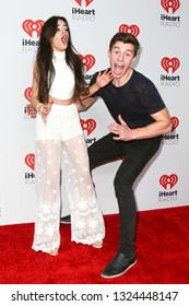 LAS VEGAS-SEP 19: Camila Cabello (L) and Shawn Mendes attend the 2015 iHeartRadio Music Festival at MGM Grand Garden Arena Night 2 on September 19, 2015 in Las Vegas, Nevada.