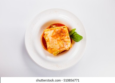 "Lasagna ""Bolognese"" on a white plate on a light background (top view)"