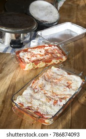 lasagna with bolognese sauce and mozzarella in a glass pyrex