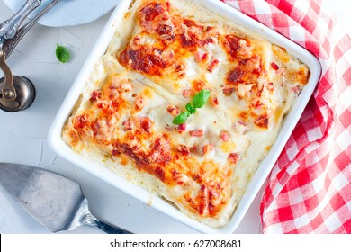 Lasagna with cheese on a white table, top view