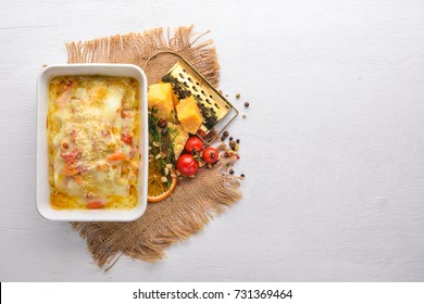 Lasagna Italian cuisine. Top view. Free space for text. On a wooden background.