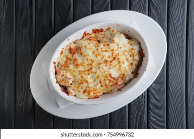 Lasagna Italian cuisine. Top view. Plate on a wooden background.