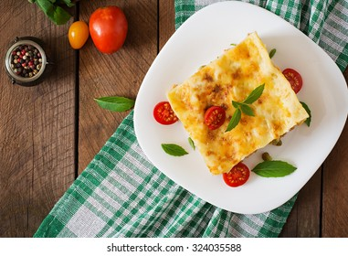 Lasagna with minced meat, green peas and sauce. Top view