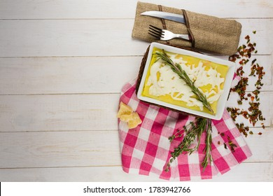 lasagna with rosemary cheese on wooden background - Shutterstock ID 1783942766
