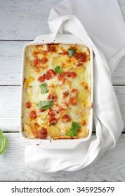 lasagna in white baking dish, top view