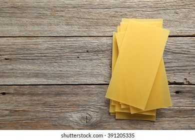 Lasagne sheets pasta on a grey wooden table
