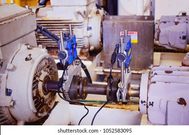 Laser alignment of shaft centrifugal pump. Check alignment and re-adjust. Laser alignment check rotating equipment and re-adjust. Black and white.