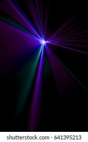Laser beam purple on a black background