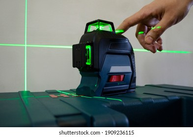 laser building level with green beams - Shutterstock ID 1909236115