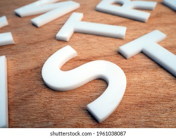 laser cut acrylic white letters on wood.