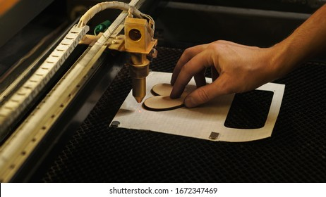 Laser cutting beam high precision on a plywood sheet. Modern technology of wood cutting. laser cut wooden 3d symbol of valentine's day. Industrial laser engraving. CNC laser. Masterclass, workshop
