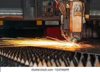 Laser cutting machine cuts the metal with sparks
