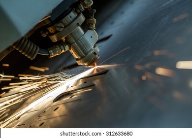 Laser cutting of metal sheet, close-up