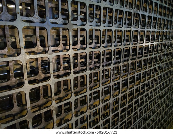 Laser cutting sheet steel waste grid perspective background with selective focus