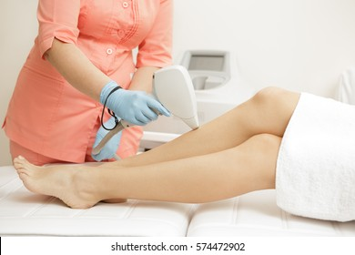Laser depilation. Cropped shot of a woman getting laser hair removal procedure on her legs beauty laser treatment salon clinic cosmetology beautician professional profession body care concept