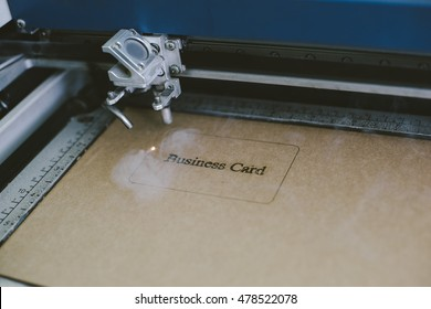 Laser engraving business card from recycled cardboard