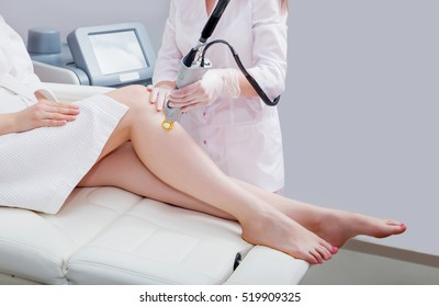 Laser epilation and cosmetology.at cosmetic beauty spa clinic. Hair removal cosmetology procedure from a therapist. Cosmetology and SPA concept.