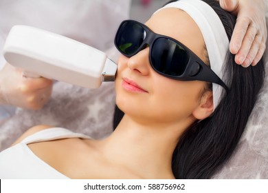 Laser epilation and cosmetology.at cosmetic beauty spa clinic. Hair removal cosmetology procedure from a therapist. Cosmetology and SPA concept