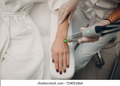 Laser epilation and cosmetology. Hair removal cosmetology procedure. Laser epilation and cosmetology. Cosmetology and SPA concept.