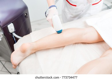 Laser epilation and cosmetology. Hair removal on ladies legs. at cosmetic beauty spa clinic. Cosmetology procedure from a therapist