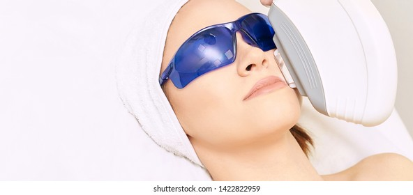 Laser facial hair removal. Cosmetology ipl device. Woman body in clinic. Medical beauty girl. Acne salon treatment tool.