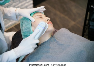 Laser or frequency Skin Tightening Face Lift treatment procedure involves.Young woman receiving laser treatment.