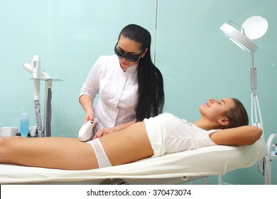 Laser hair removal removal bikini. Beautician makes the procedure body hair removal.