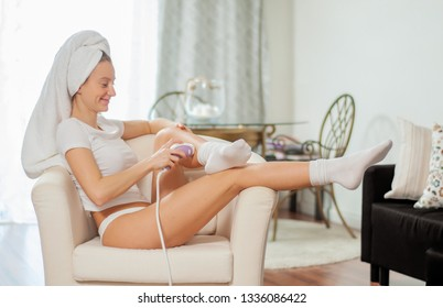 Laser hair removal. Epilation. Woman removing hair on her legs at home. Body Care.