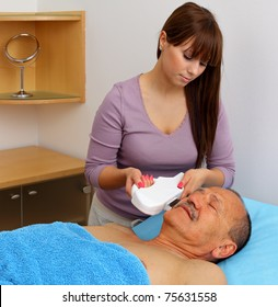 Laser hair removal on male face.