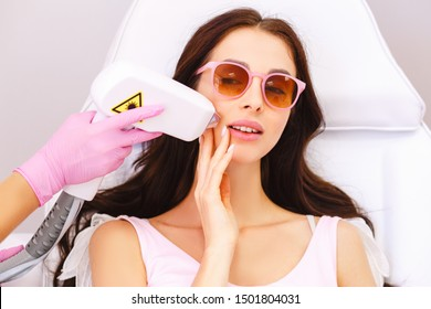 Laser hair removal in professional beauty studio.