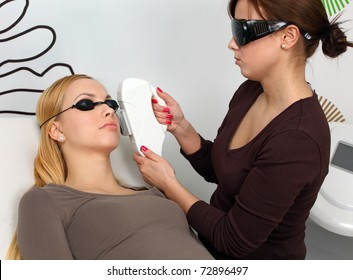 Laser hair removal in professional studio. Pro at work with her client.