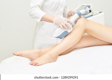 Laser ipl device in doctor hand. Woman body hair removal. Perfect epilator. Cosmetology leg technology.