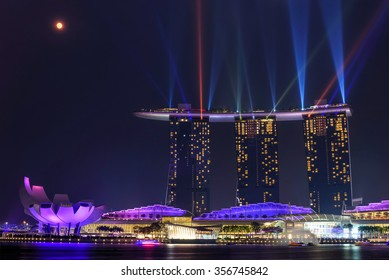 Laser lighting show over Singapore landmarks and tourist attraction. Colorful cityscape concept