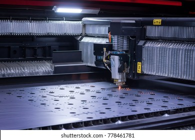 laser machine cutting big sheet metal. Sparks fly from laser by automatic cutting CNC, PLC machine. fabricate work, factory, production