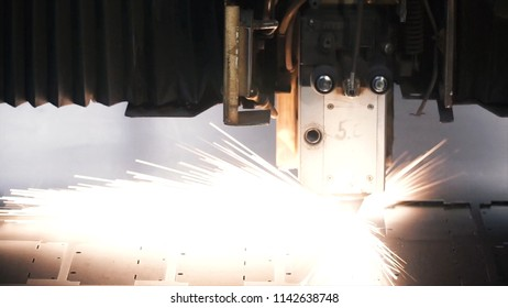 Laser machine cutting of sheet metal. Clip. Sparks fly from laser by automatic cutting CNC, PLC machine