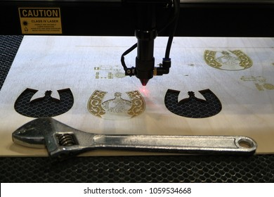 The laser machine produces cutting and engraving of plywood.