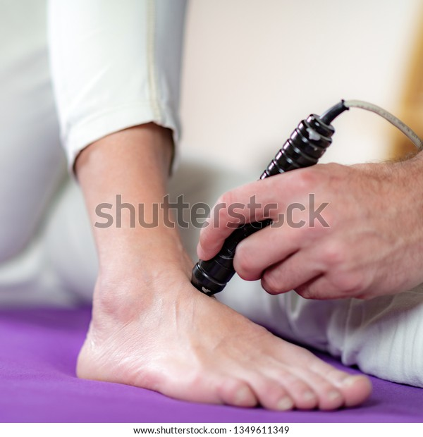 Image result for laser therapy in physiotherapy on foot""