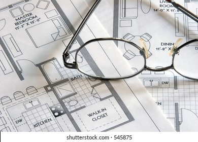 Laser printouts of architectural plan drawings with glasses