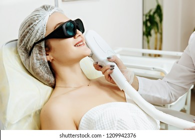 Laser removal of skin discoloration.Cosmetic clinic, woman during laser facial surgery.